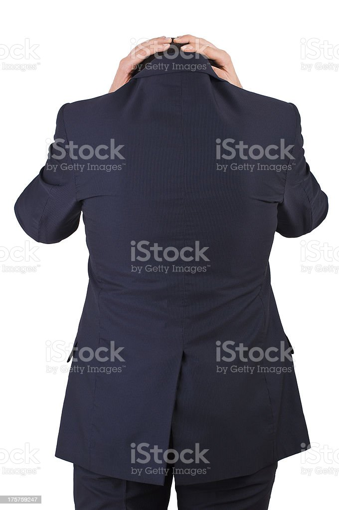 Businessman suffering from head pain. stock photo