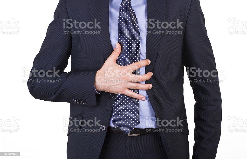 Businessman suffering from heartburn. stock photo