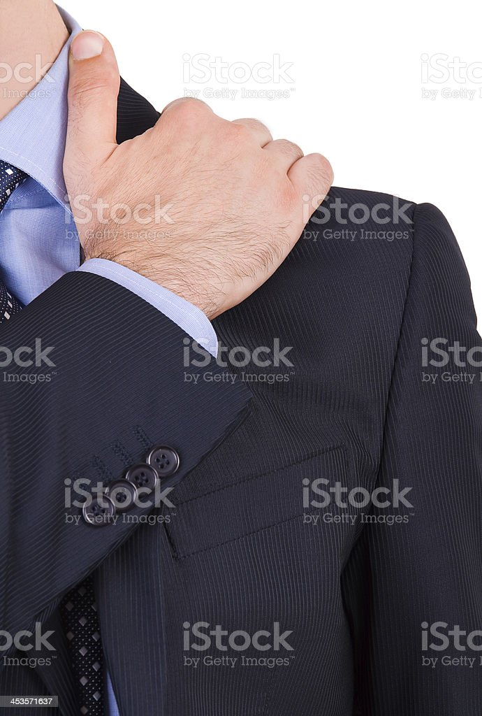 Businessman suffering from shoulder pain. stock photo
