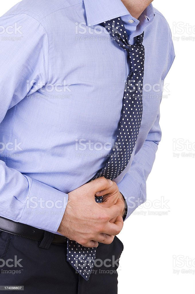 Businessman suffering from stomach pain. stock photo