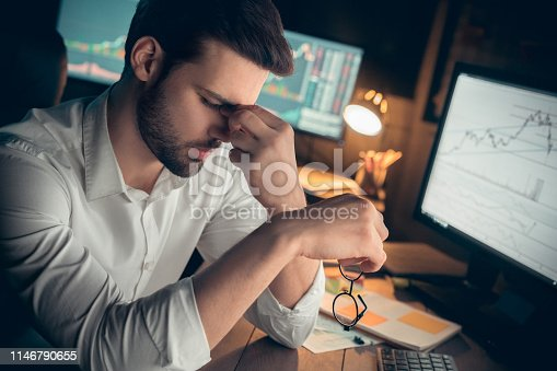 Tired businessman suffers from computer vision syndrome taking off glasses massaging eyes working late, fatigued trader feels eyestrain, has bad blurry eyesight problem, headache or overwork concept