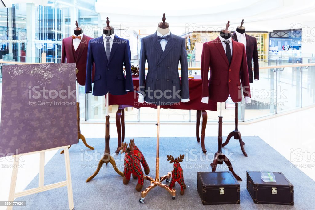 businessman suit on model in shopping mall stock photo