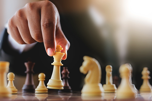 Businessman suit with chess board game. Plan stratgy and tactic concept