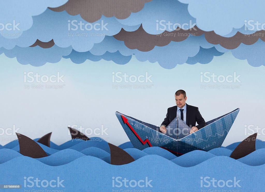 Businessman surrounded by sharks in stormy sea. stock photo