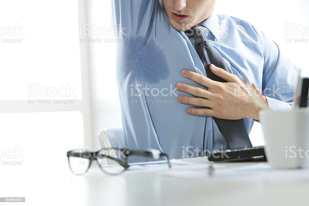 Businessman sweating stock photo