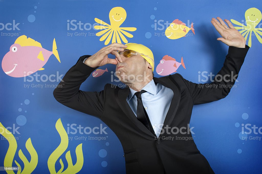 Businessman swimming in the deep sea royalty-free stock photo