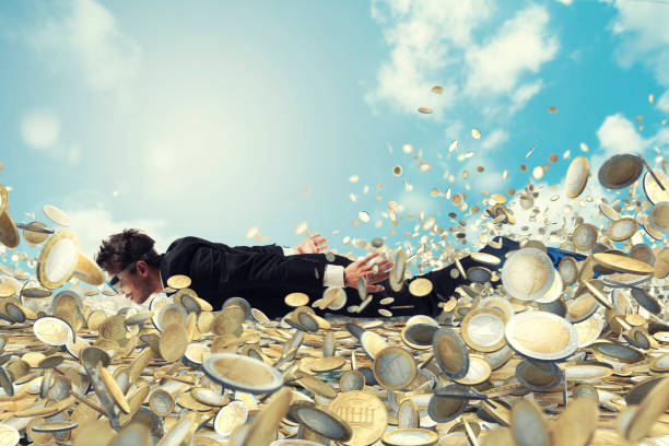Businessman swims in a sea of money - foto stock