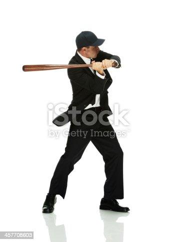 istock Businessman swinging with baseball bat 457708603