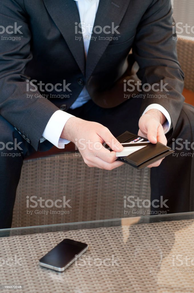 Businessman takes his credit card from the purse royalty-free stock photo