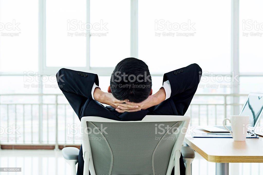 Businessman taking a break at work stock photo