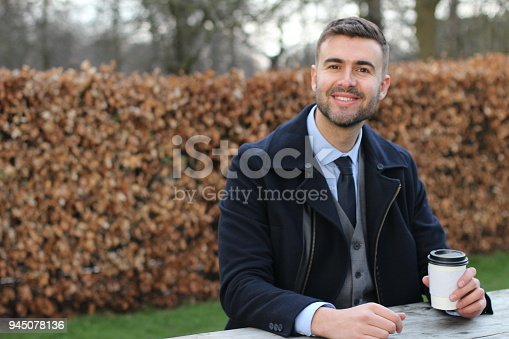 580112984 istock photo Businessman taking a coffee break 945078136