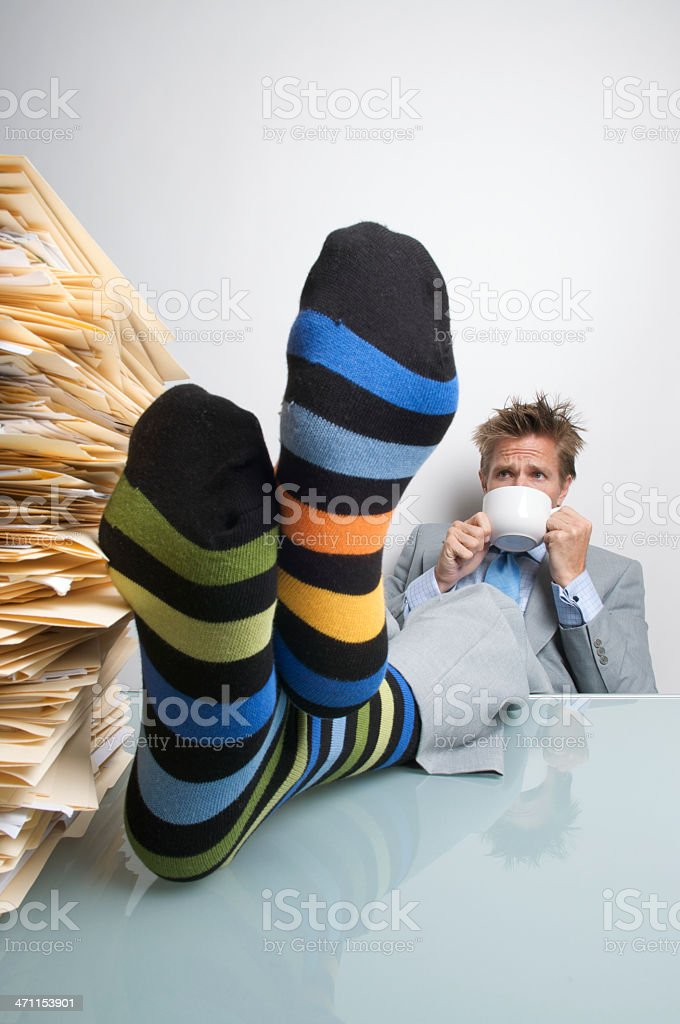 Businessman Taking a Filing Break with Feet up on Desk royalty-free stock photo