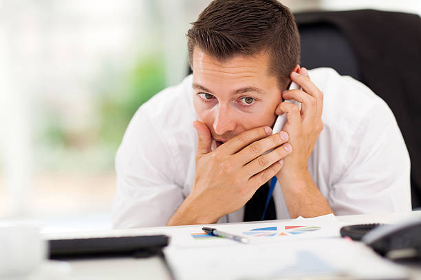 businessman taking a private call stock photo