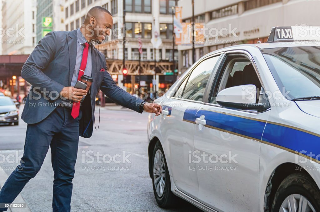 Businessman taking a Taxi Ride in Chicago stock photo