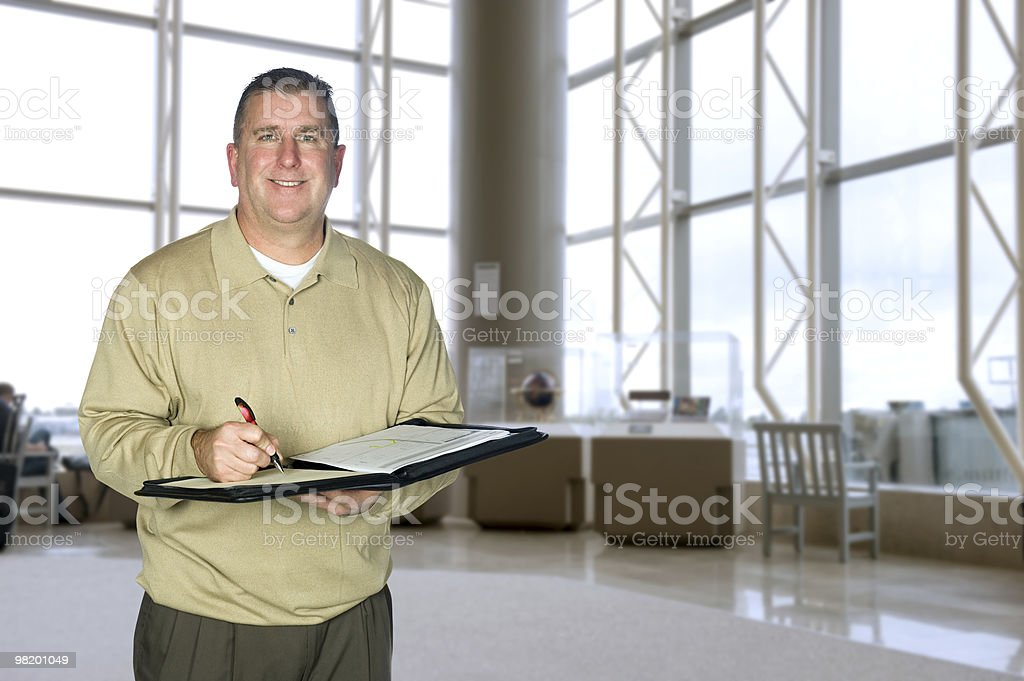 Businessman taking notes in lobby royalty-free stock photo