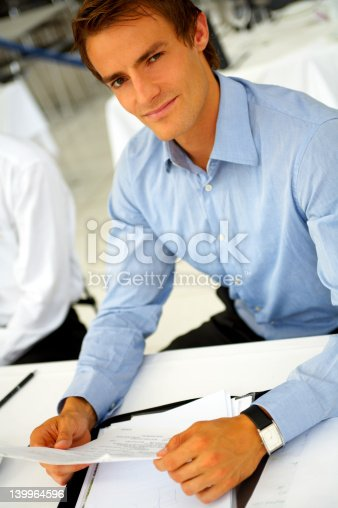 530281723istockphoto Businessman taking notes 139964596