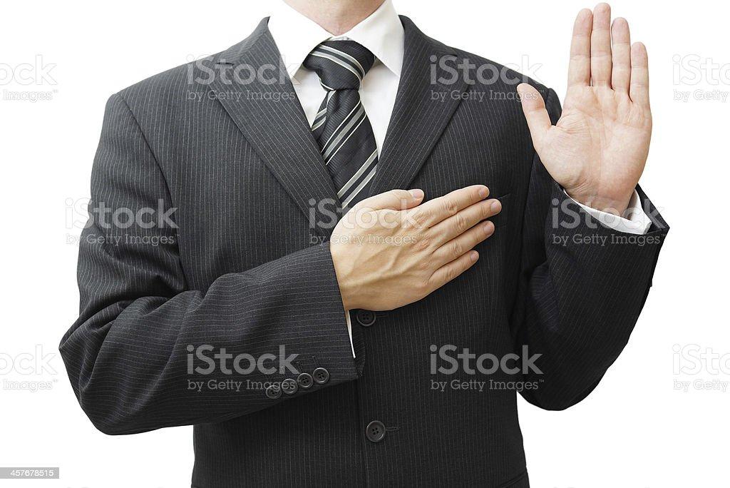 Businessman taking oath stock photo
