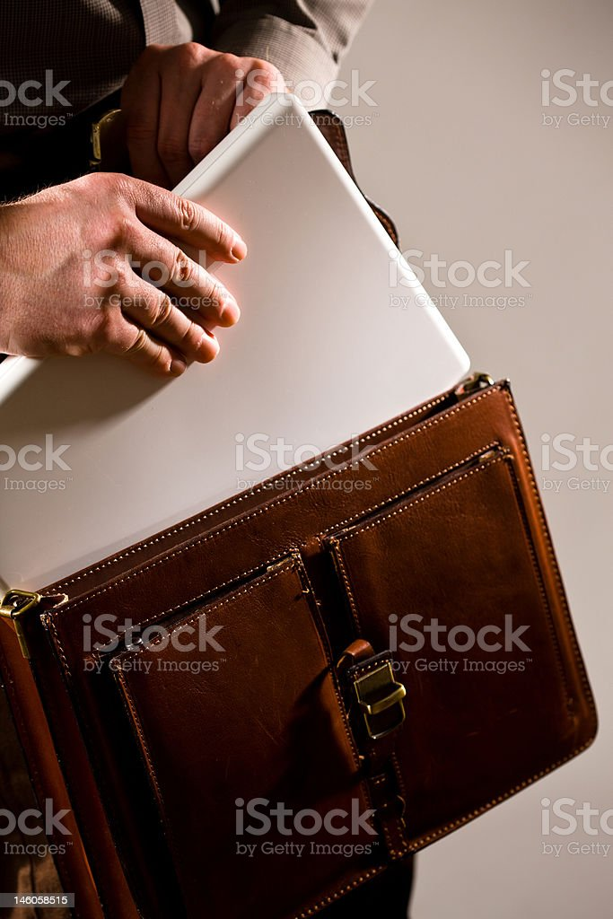Businessman taking out laptop from case royalty-free stock photo