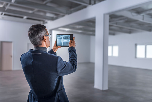 Businessman taking photo of empty office space