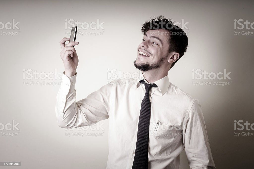 businessman taking photo with telephone stock photo