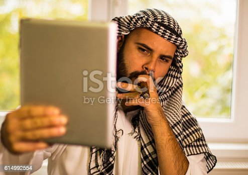 491496340 istock photo Businessman taking selfie with tablet 614992554