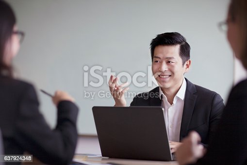 1063657732 istock photo Businessman talking in group office meeting 637924348