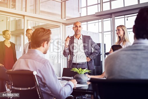 istock Businessman talking in meeting 842868292