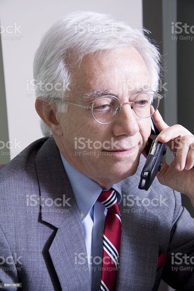 Businessman Talking on a Cell Phone royalty free stockfoto