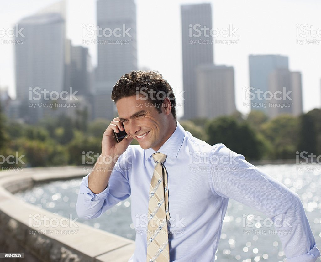 Businessman talking on cell phone at waterfront royalty-free stock photo