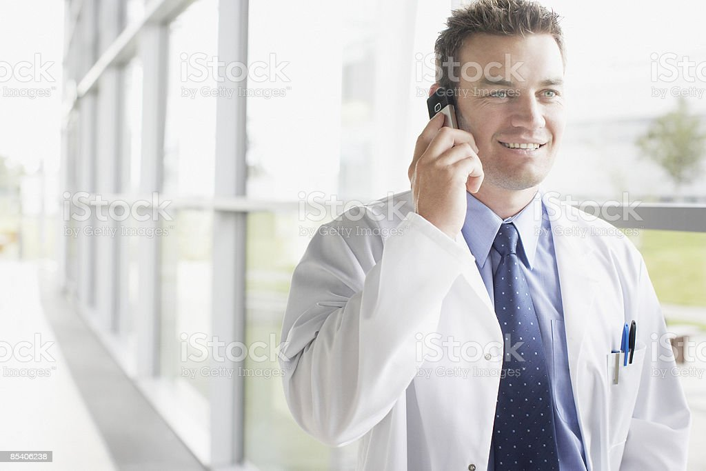 Businessman talking on cell phone in corridor royalty-free stock photo