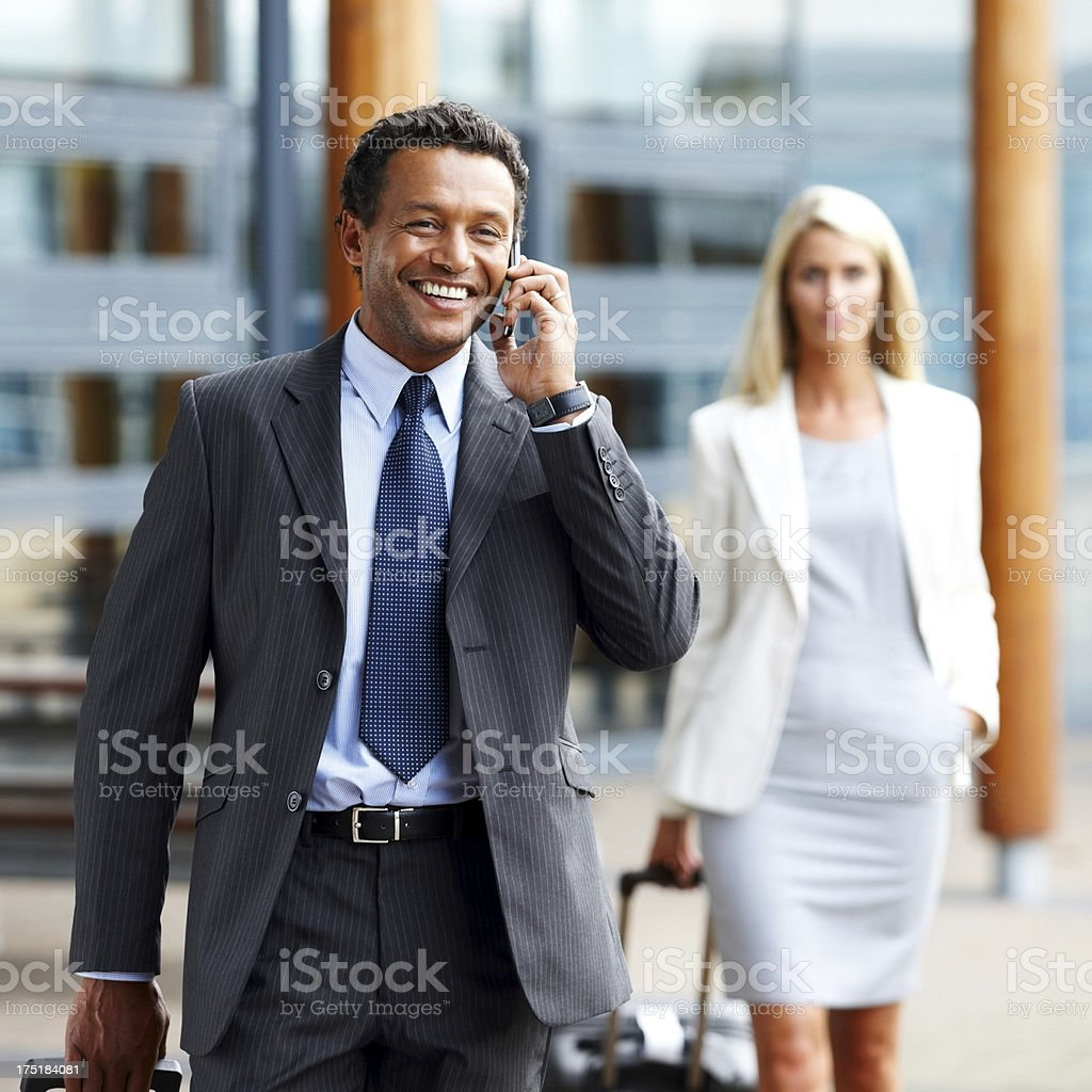 Businessman talking on cell phone - Outdoors royalty-free stock photo