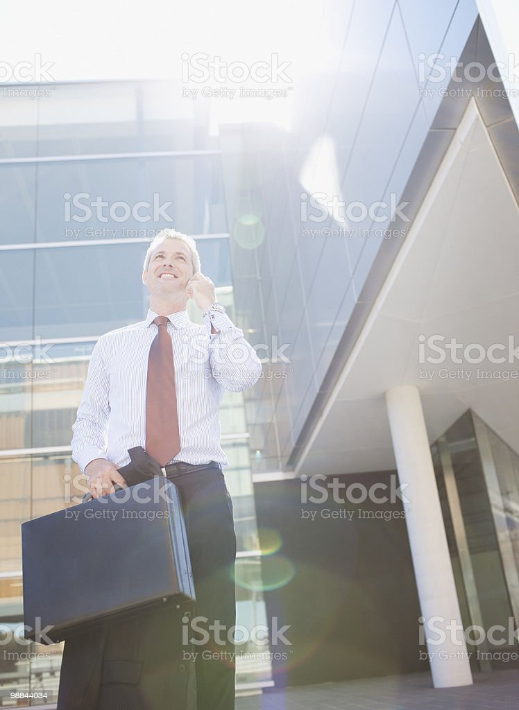Businessman talking on cell phone outdoors royalty-free stock photo