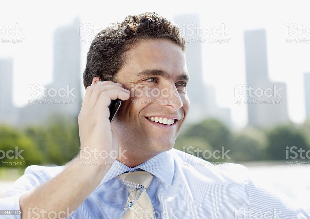 Businessman talking on cell phone outdoors 免版稅 stock photo