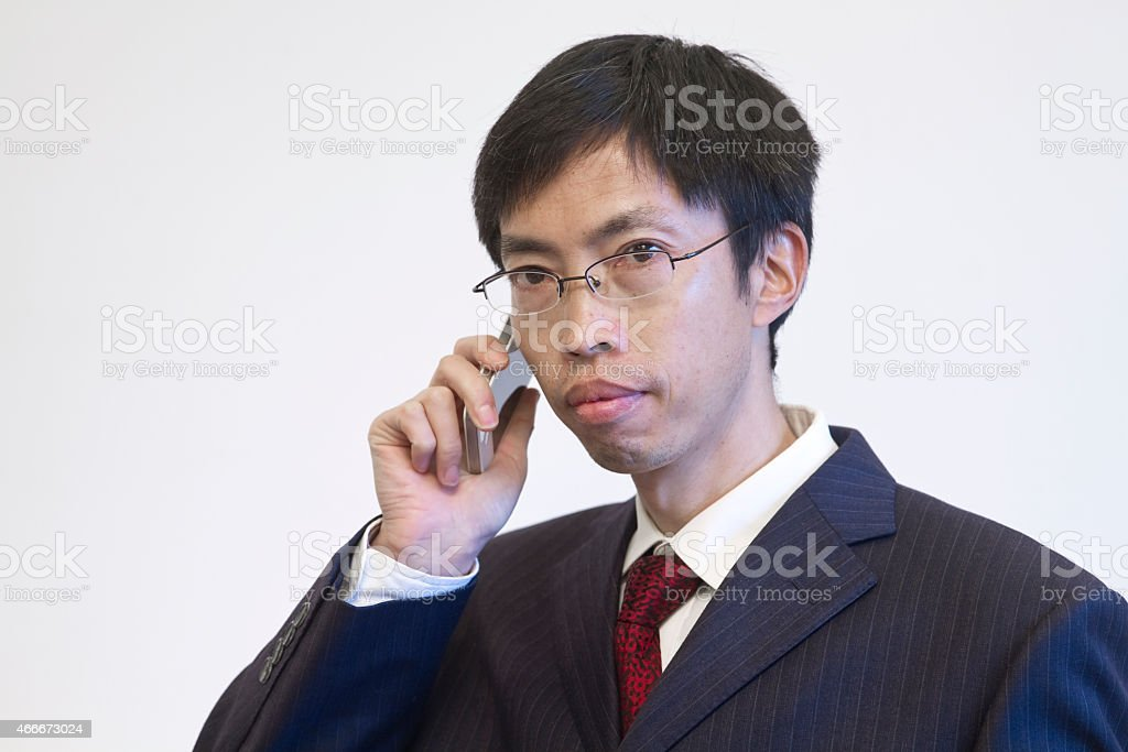 Businessman talking on his mobile phone. stock photo