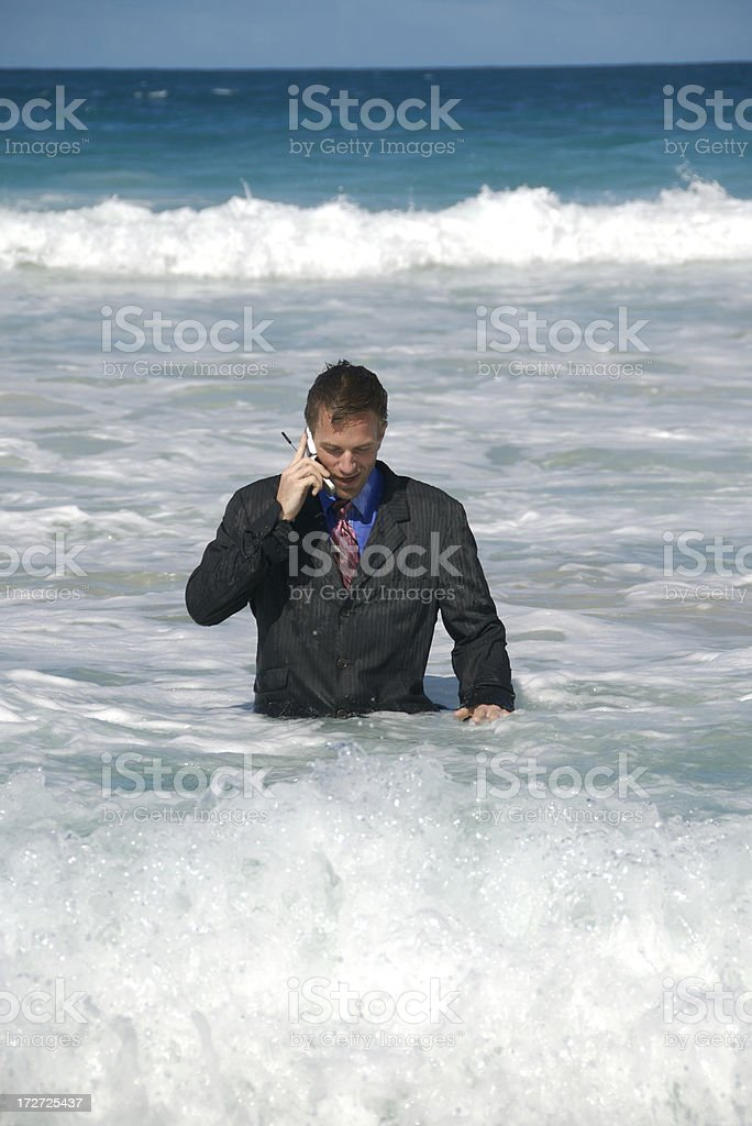 Businessman Talking on Mobile Phone from the Sea royalty-free stock photo