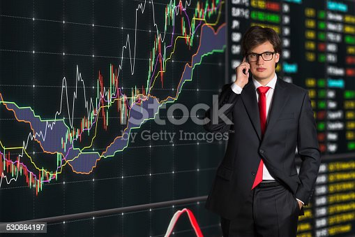 businessman talking on phone and graph on virtual screen