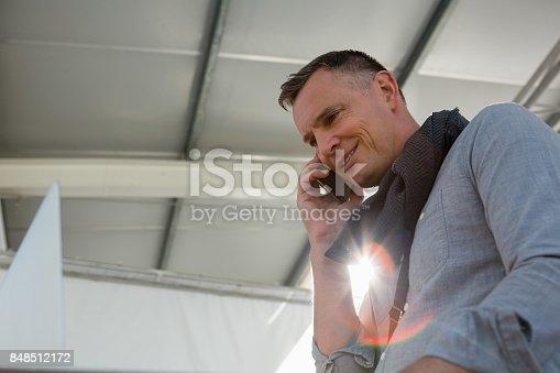 istock Businessman talking on smart phone at office 848512172