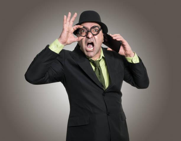 hombre de negocios hablando en smartphone - studioimagen73 fotografías e imágenes de stock