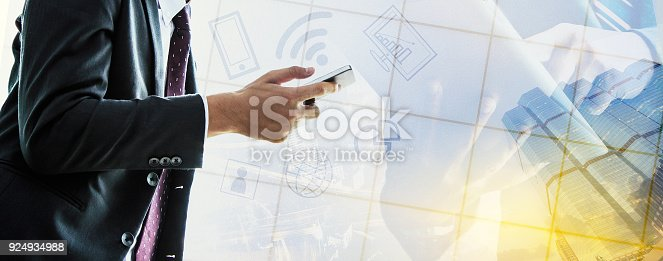 istock Businessman talking on the phone and using a tablet. 924934988