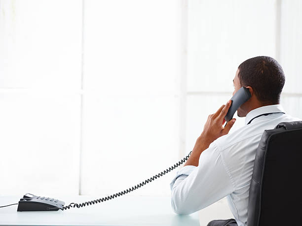 Businessman talking on the phone in his office stock photo