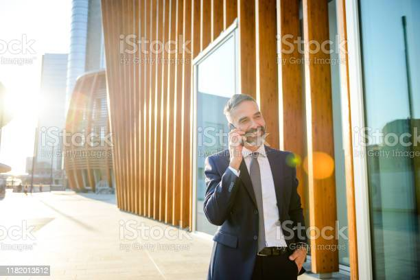 Businessman Talking On The Phone Stock Photo - Download Image Now