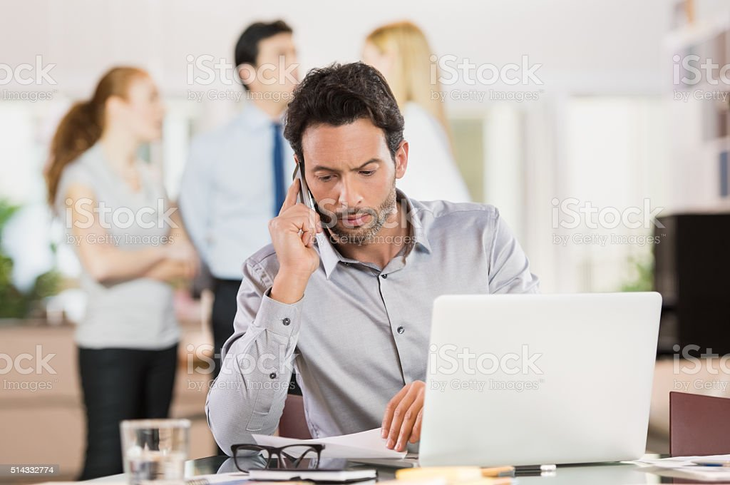 Businessman talking over phone stock photo