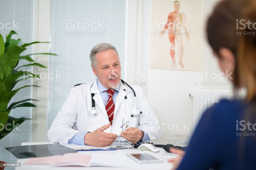 Businessman talking to a patient royalty-free stock photo