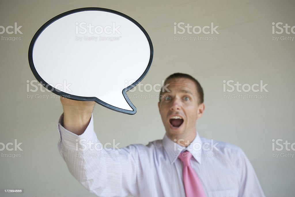 Businessman Talking Under Big Speech Bubble royalty-free stock photo