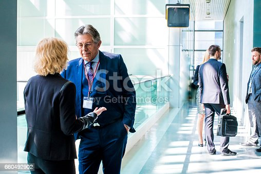 487670635istockphoto Businessman talking with his woman colleague 660492902
