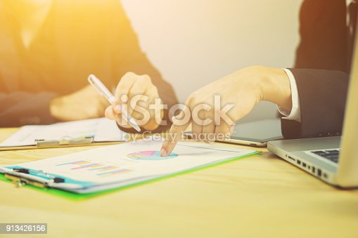 954578184 istock photo Businessman team meeting present.professional investor working with new startup project. Finance managers task.Digital tablet laptop computer design, marketing business plan ,vintage color 913426156