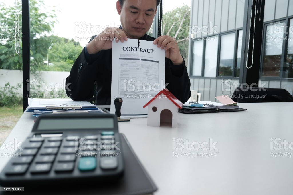 businessman tearing agreement document. breaking contract stock photo