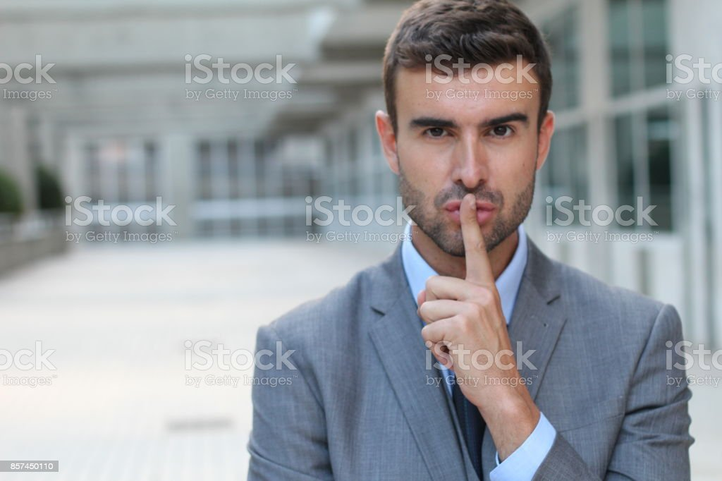 Businessman telling you to shut up royalty-free stock photo
