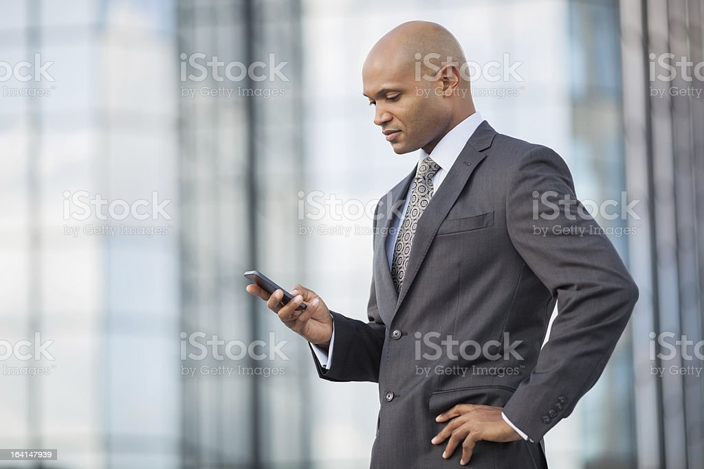 Businessman Text Messaging On Phone royalty-free stock photo