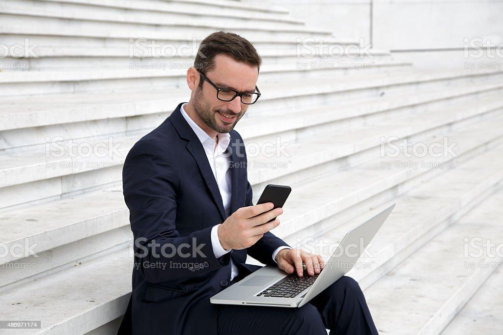 Businessman text messaging stock photo